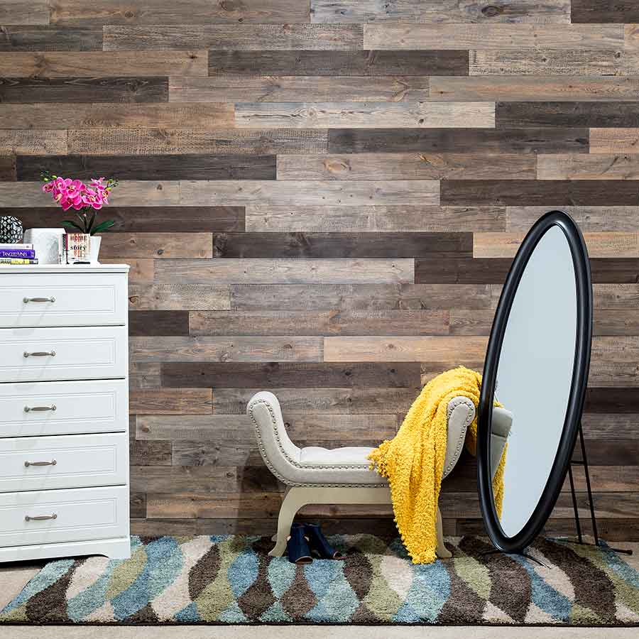 Rustic Grove Mixed-Brown planks with mirror on bedroom wall.