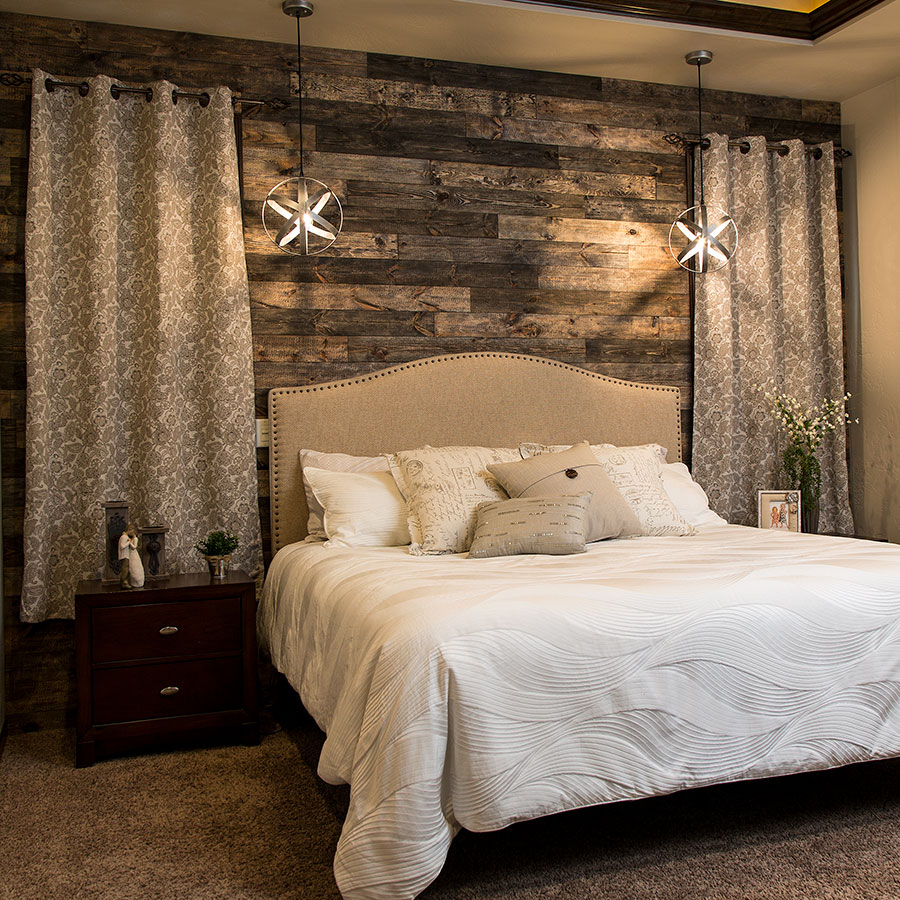 Rustic Grove planks in Mixed Brown on bedroom wall.