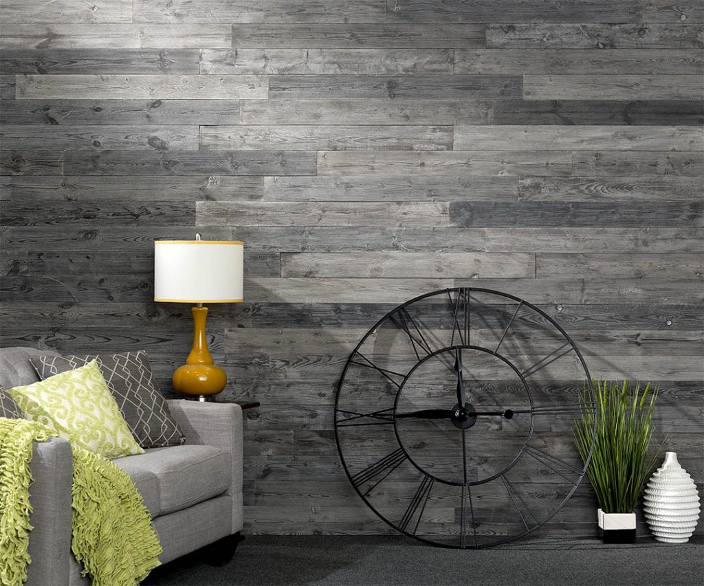 Rustic Grove Dark Gray wall planks with table lamp and clock.