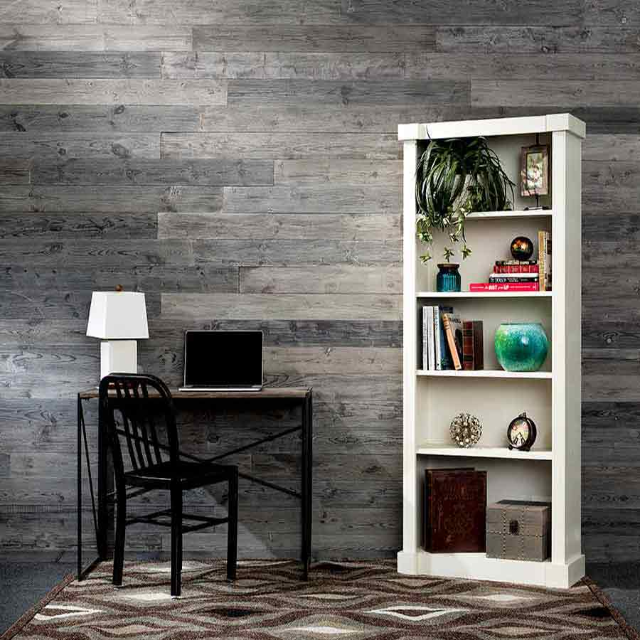 Rustic Grove Dark Gray wall planks with bookcase and table.
